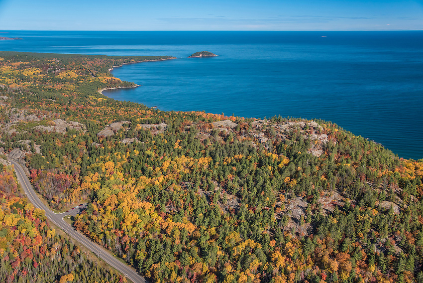 Aerial photography of  the rugged Lake Superior shoreline north of Marquette, Michigan during fall color season. Areas shown include County Road 550, Sugarloaf Mountain lookout, Wetmore Landing Beach and Little Presque Isle.