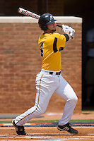 Joe Van Meter #4 of the VCU Rams follows through on his swing against the St. John's Red Storm at the Charlottesville Regional of the 2010 College World Series at Davenport Field on June 5, 2010, in Charlottesville, Virginia.  The Red Storm defeated the Rams 8-6.  Photo by Brian Westerholt / Four Seam Images