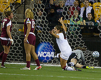 Stanford Cardinals vs Florida State Seminoles in the NCAA 2011 Women's College Cup semifinals.Stanford won 3-0.  Alina Garciamendez heads the ball for the third goal.