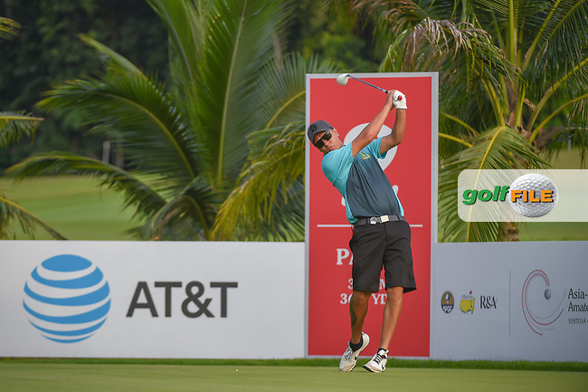 Kristopher WILLIAMSON (COK) watches his tee shot on 2 during Rd 1 of the Asia-Pacific Amateur Championship, Sentosa Golf Club, Singapore. 10/4/2018.<br /> Picture: Golffile | Ken Murray<br /> <br /> <br /> All photo usage must carry mandatory copyright credit (© Golffile | Ken Murray)
