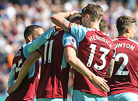 Burnley's Chris Wood celebrates scoring his side's first goal with teammates Jeff Hendrick and Aaron Lennon<br /> <br /> Photographer Alex Dodd/CameraSport<br /> <br /> The Premier League - Burnley v Bournemouth - Sunday 13th May 2018 - Turf Moor - Burnley<br /> <br /> World Copyright &copy; 2018 CameraSport. All rights reserved. 43 Linden Ave. Countesthorpe. Leicester. England. LE8 5PG - Tel: +44 (0) 116 277 4147 - admin@camerasport.com - www.camerasport.com