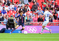 August 06, 2012..Japan's Yukari Kinga #2, and France's Gaetane Thiney #17,  during Semi Final match at the Wembley Stadium on day ten in Wembley, England. Japan defeats France 2-1 to reach Women's Finals of the 2012 London Olympics.