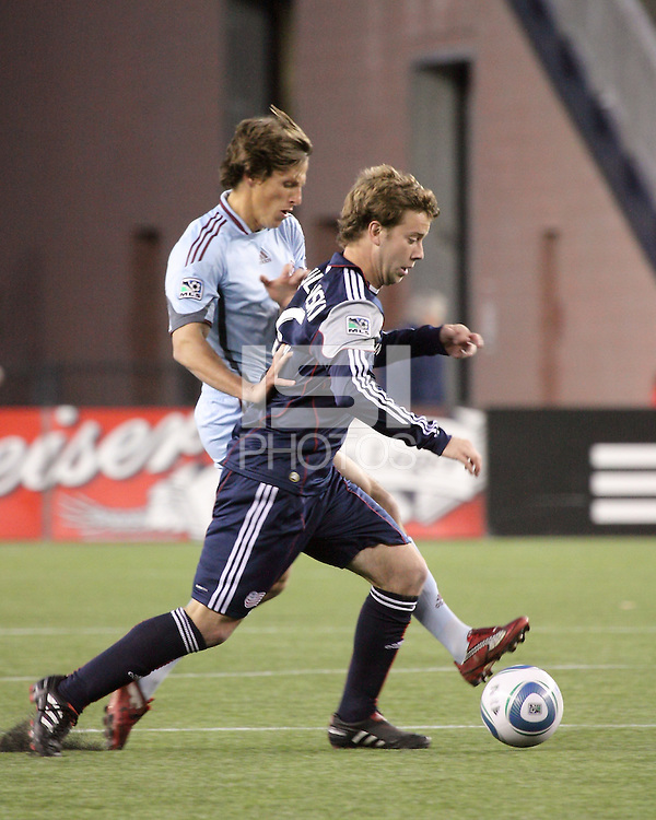 Colorado Rapids midfielder Wells Thompson (15) and New England Revolution forward Zack Schilawski (15) battle for the ball in the midfield. The Colorado Rapids defeated the New England Revolution, 2-1, at Gillette Stadium on April 24.2010