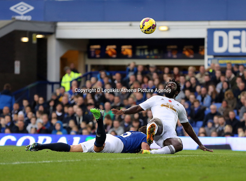 Liverpool, UK. Saturday 01 November 2014<br /> Pictured: Wilfried Bony of Swansea is brought down byGareth Barry of Everton.<br /> Re: Premier League Everton v Swansea City FC at Goodison Park, Liverpool, Merseyside, UK.