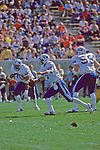 6 Robbie Bosco scramble in the pocket during the BYU Homecoming game vs Wyoming.<br /> <br /> Oct. 13, 1984<br /> FTB 7 OCT84P8<br /> <br /> Photo by Mark Philbrick/BYU<br /> <br /> &copy; BYU PHOTO 2009<br /> All Rights Reserved<br /> photo@byu.edu  (801)422-7322