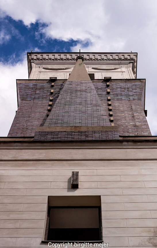 One of the towers on a Church in Prage, at Jirih Z Podebrad Namesti (Square) photographed upwards,against the blue summer sky.