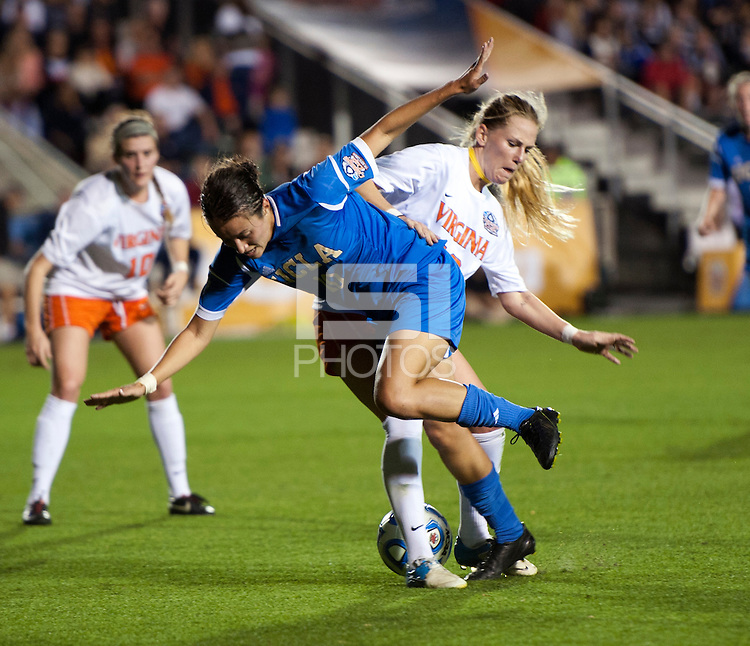 Kodi Lavrusky (10) of UCLA is fouled by Shasta Fisher (12) of Virginia during the Women's College Cup semifinals at WakeMed Soccer Park in Cary, NC. UCLA advance on penalty kicks after typing Virginia, 1-1 in regulation time.