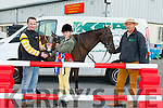 On Tuesday morning at Kellihers Agri,Ballymullen Tralee, Siabh Norris,Blennerville Aquestrian Centre, was presented with the Open Working Championship Cup from sponsor Noel Kelliher, also in pic is Tim Hurley from Blennerville Equestrian Centre.Pic Joe Hanley