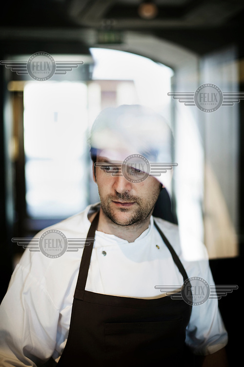 Chef Rene Redzepi works in the kitchen of his two Michelin star restaurant Noma, which was voted the best restaurant in the world in 2010.