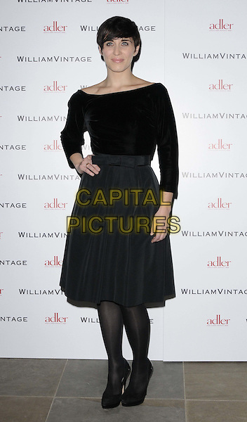 Vicky McClure.attended the WilliamVintage & Gillian Anderson private dinner, St Pancras Renaissance Hiotel, Euston Rd., London, England, UK, .10th February 2012..full length black velvet long sleeve top dress   bow tights hand on hip .CAP/CAN.©Can Nguyen/Capital Pictures.