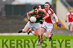 Daniel O'Sullivan Rathmore tackles Kilcummin Matthew Keane during the East Kerry semi final in Fitzgerald Stadium on Saturday