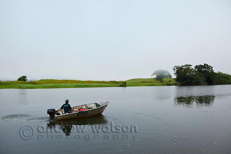 Fisherman in dinghy on Daintree River.  Daintree National Park, Queensland, Australia