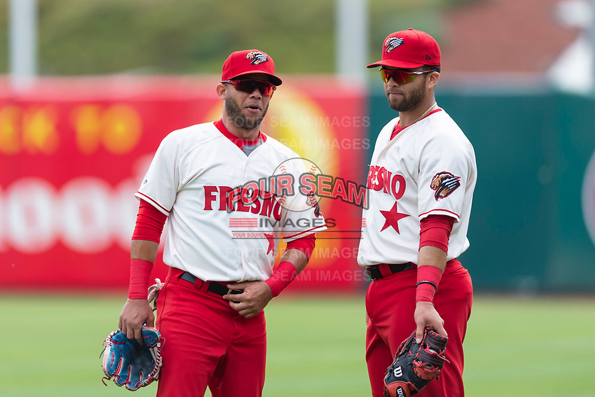 Fresno Grizzlies outfielder Yadiel Hernandez (13) and first baseman Jose Marmelejos (29) before a game against the Reno Aces at Chukchansi Park on April 8, 2019 in Fresno, California. Fresno defeated Reno 7-6. (Zachary Lucy/Four Seam Images)