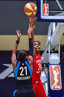 Washington, DC - August 31, 2018: Washington Mystics forward LaToya Sanders (30) blocks the shot of Atlanta Dream guard Renee Montgomery (21) during semi finals playoff game between Atlanta Dream and Wasington Mystics at the Charles Smith Center at George Washington University in Washington, DC. (Photo by Phil Peters/Media Images International)