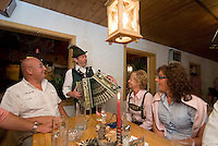 Bad Aussee, Ausseerland, Steiermark, Styria, Austria, September 2008. Traditional Harmonica Music food in the knoedel alm. and The province of Styria is known for its green alpine landscape, good food and many lakes. Photo by Frits Meyst/Adventure4ever.com