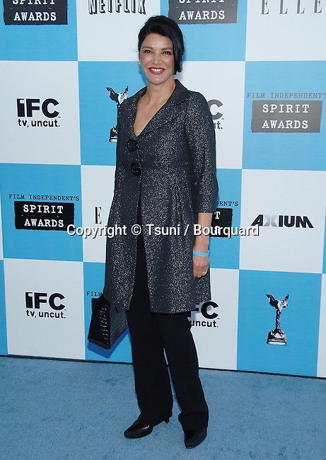 Shohreh Aghdashloo arriving at the Film Independent's 22th SPIRIT AWARDS in Santa Monica Beach in Los Angeles.<br /> <br /> full length<br /> smile<br /> eye contact<br /> pant suit