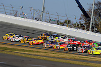 The field races into turn 3 led by Clint Bowyer (#33).