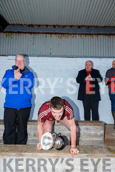 Dermot Walsh of Super Valu Cahersiveen, sponsor of the South Kerry Senior Football Championship presents Dromids Captain Niall Ó Sé with the Jack Murphy Cup on Saturday in Ballinskelligs after their 2 point win over St Marys after extra time