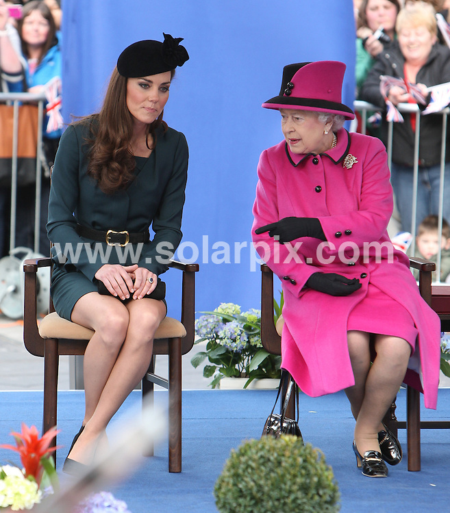 **ALL ROUND PICTURES FROM SOLARPIX.COM**                                             **WORLDWIDE SYNDICATION RIGHTS**                                                                                  Caption:HRH The Queen, Duke Of Edinburgh,Katherine Duchess Of Cambridge Royal Visit To Leicester City Centre..The Duchess of Cambridge and the Queen gave a lesson in how to travel in style today as they kicked off the Diamond Jubilee tour of the UK..The Royals looked a far cry from the average train commuter, causing quite a stir at St Pancras station in London..Kate looked to the 1940's for inspiration, wearing an elegant teal peplum suit by L.K. Bennett which consisted of the £395 'Jude' jacket and £225 'Davina' dress. She wore a pillbox hat by James Lock hat..The Queen, 85, wore a cerise cashmere dress and coat with black trim by Angela Kelly, and a matching hat by the same designer.                                                                               This pic: The Queen & Katherine Duchess Of Cambridge                                                                                             JOB REF:14545        MSR       DATE:08.03.2012                                                            **MUST CREDIT SOLARPIX.COM OR DOUBLE FEE WILL BE CHARGED**                                                                      **MUST AGREE FEE BEFORE ONLINE USAGE**                               **CALL US ON: +34 952 811 768 or LOW RATE FROM UK 0844 617 7637**