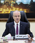Palestinian Prime Minister Rami Hamdallah chairs a meeting of council of Ministers in the West Bank city of Ramallah, on June 13, 2017. Photo by Prime Minister Office