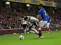 Nicky Clark fouled by Emilson Cribari in the Rangers v Queen of the South Quarter Final match in the Ramsdens Cup played at Ibrox Stadium, Glasgow on 18.9.12.
