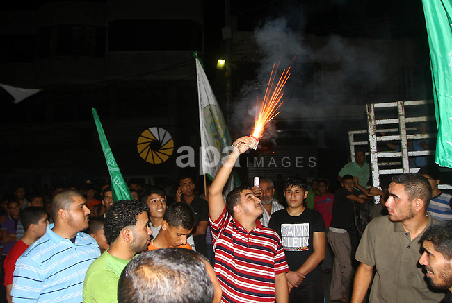 Palestinian members of Hamas celebrate a deal that will see Palestinian detainees freed in exchange for captured Israeli soldier Gilad Shalit on October 11, 2011, in Deir al-Balah in the central Gaza Strip. Shalit was captured in 2006 by Hamas-allied militants in the Gaza Strip.. Photo by Ashraf Amra