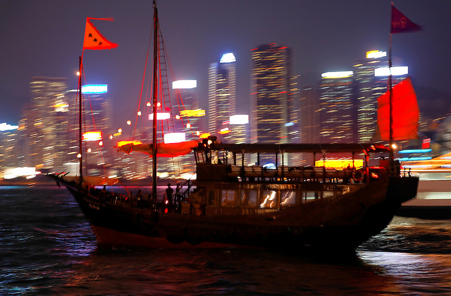Boat on Victoria Harbour at dusk, Hong Kong SAR, China, Asia