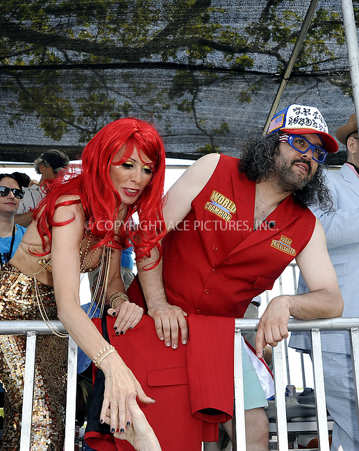 WWW.ACEPIXS.COM<br /> <br /> June 22 2013, New York City<br /> <br /> King Neptune Judah Friedlander (R) and Queen Mermaid Carole Radziwill  at the 2013 Mermaid Parade at Coney Island on June 22, 2013 in New York City.<br /> <br /> By Line: Curtis Means/ACE Pictures<br /> <br /> <br /> ACE Pictures, Inc.<br /> tel: 646 769 0430<br /> Email: info@acepixs.com<br /> www.acepixs.com