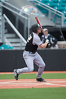 John Mullen (42) of the Bryant Bulldogs follows through on his swing against the Coastal Carolina Chanticleers at Springs Brooks Stadium on March 13, 2015 in Charlotte, North Carolina.  The Chanticleers defeated the Bulldogs 7-2.  (Brian Westerholt/Four Seam Images)