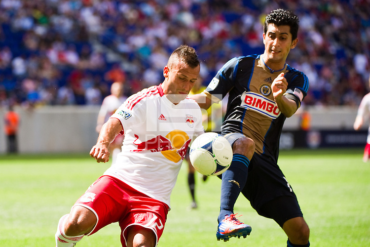 Jonathan Borrajo (12) of the New York Red Bulls and Josue Martinez (17) of the Philadelphia Union. The New York Red Bulls defeated the Philadelphia Union 2-0 during a Major League Soccer (MLS) match at Red Bull Arena in Harrison, NJ, on July 21, 2012.