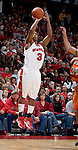 MADISON, WI - NOVEMBER 8: Guard Trevon Hughes #3 of the Wisconsin Badgers shoots the ball against the Carroll College Pioneers at the Kohl Center on November 8, 2006 in Madison, Wisconsin. The Badgers beat the Pioneers 81-61. (Photo by David Stluka)