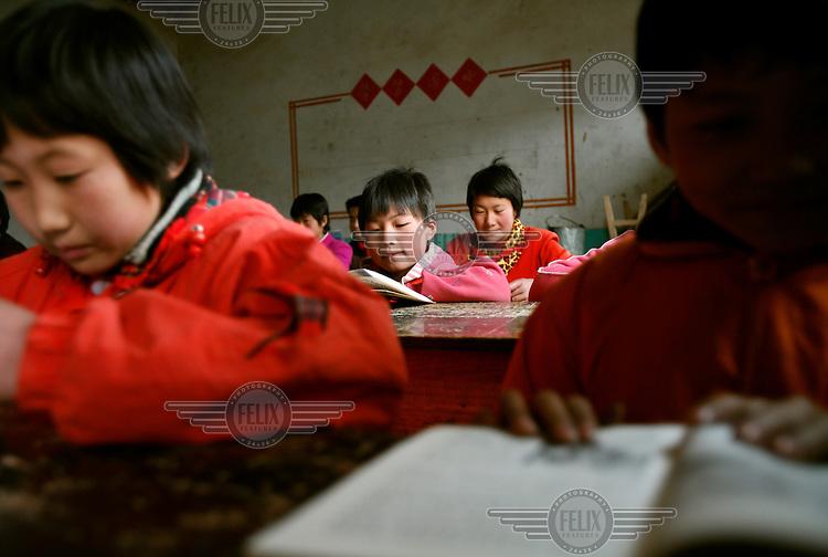 Schoolchildren study in a classroom at Linfang Elementary School..