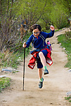 happy jumping girl, Estes Park, Colorado, USA