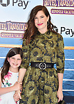 WESTWOOD, CA - JUNE 30: Kathryn Hahn (R) and Mae Sandler attend the Columbia Pictures and Sony Pictures Animation's world premiere of 'Hotel Transylvania 3: Summer Vacation' at Regency Village Theatre on June 30, 2018 in Westwood, California.