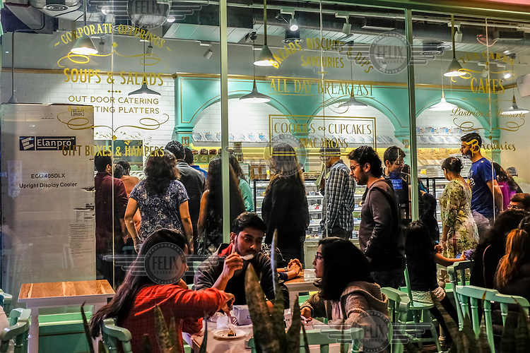 People eating at a cafe on a Sunday night in Cybercity in Gurgoan.