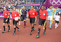 Men's Olympic Football match Spain v Japan on 26.7.12...Match Referee Mark Geiger of the United States of America leads out the teams, during the Spain v Japan Men's Olympic Football match at Hampden Park, Glasgow............