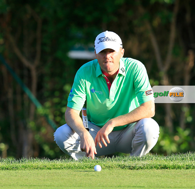 Michael Hoey (NIR) lines up his putt on the 8th green during Thursday's Round 1 of the 2016 Portugal Masters held at the Oceanico Victoria Golf Course, Vilamoura, Algarve, Portugal. 19th October 2016.<br /> Picture: Eoin Clarke | Golffile<br /> <br /> <br /> All photos usage must carry mandatory copyright credit (&copy; Golffile | Eoin Clarke)