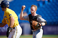 Army West Point catcher Jon Rosoff (7) chases Jonathan Engelmann (2) in a run down during a game against the Michigan Wolverines on February 17, 2018 at First Data Field in St. Lucie, Florida.  Army defeated Michigan 4-3.  (Mike Janes/Four Seam Images)