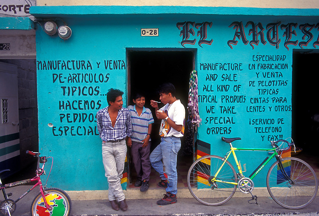 Men in front of craft souvenir shop, Panahachel, Solola Department, Guatemala, Central America