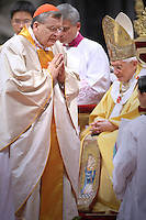 Pope Benedict XVI (L) gives his  Cardinal US Raymond leo Burke  (R) during the Eucharistic celebration with the new cardinals on November 21, 2010 at St Peter's basilica at The Vatican. 24 Roman Catholic prelates joined the day before the Vatican's College of Cardinals, the elite body that advises the pontiff and elects his successor upon his death.