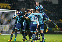 Wycombe players cover goal scorer Scott Kashket of Wycombe Wanderers as he scores to make it 2 0 during the Sky Bet League 2 match between Notts County and Wycombe Wanderers at Meadow Lane, Nottingham, England on 10 December 2016. Photo by Andy Rowland.