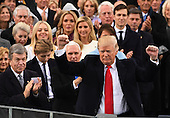President Donald Trump waves with his family in the background after delivering his  inaugural address at the Inauguration Ceremony on January 20, 2017 in Washington, D.C.  Trump became the 45th President of the United States.   <br /> Credit: Pat Benic / Pool via CNP