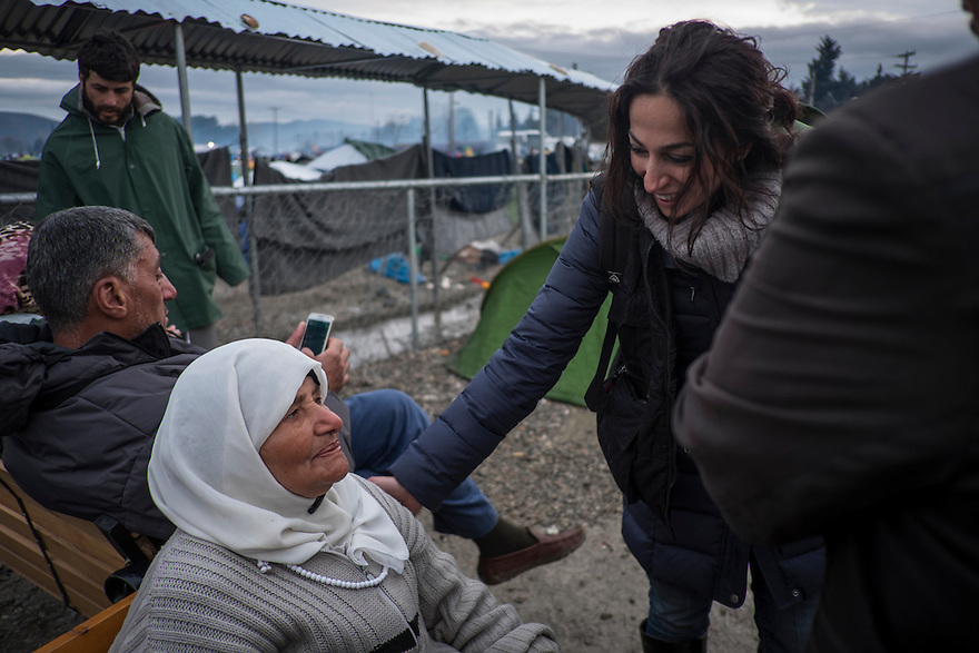 IDOMENI, GREECE-- March 10, 2016-- Sandra Hakim, IRC protection team member, speaks with a refugee at Idomeni border camp on the Macedonian border. PHOTO BY JODI HILTON FOR INTERNATIONAL RESCUE COMMITTEE