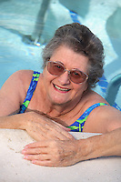 Senior Woman Enjoying Exercise At The Pool