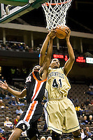 January 9, 2009:     Jacksonville forward Lehmon Colbert (41) goes up for a rebound in Atlantic Sun Conference action between the Jacksonville Dolphins and the Mercer Bears at Veterans Memorial Arena in Jacksonville, Florida.  Jacksonville defeated Mercer 80-59.