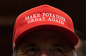 A farmer wears a United States President Donald J. Trump themed hat listens as he delivers remarks on supporting American farmers, in the Roosevelt Room at the White House in Washington, D.C. on May 23, 2019. Trump announced a $16 Billion in aid to farmers and also spoke on China tariffs, Iran and his relations with Congressional Democrats.  Photo by Kevin Dietsch/UPI<br /> Credit: Kevin Dietsch / Pool via CNP