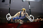 20 APR 2012: C.J. Maestas of the University of Illinois competes in the Rings competition during the Division I Men's Gymnastics Championship held at the Lloyd Noble Center on the University of Oklahoma campus in Norman, OK. The University of Illinois team finished in first place with a score of 358.85. Stephen Pingry/NCAA Photos