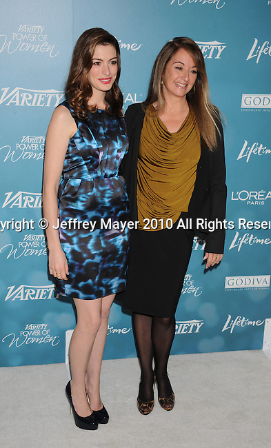 BEVERLY HILLS, CA. - September 30: Anne Hathaway (L) and Producer Susan Bymel arrive at Variety's 2nd Annual Power Of Women Luncheon at The Beverly Hills Hotel on September 30, 2010 in Beverly Hills, California.