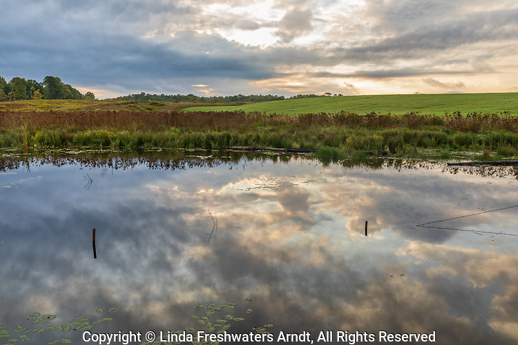 The morning clouds start to clear over a farmer's field in northern Wisconsin.