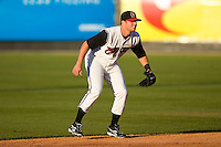 Shortstop Zach Kozart #8 of the Carolina Mudcats on defense versus the Jacksonville Suns at Five County Stadium May 19, 2009 in Zebulon, North Carolina. (Photo by Brian Westerholt / Four Seam Images)